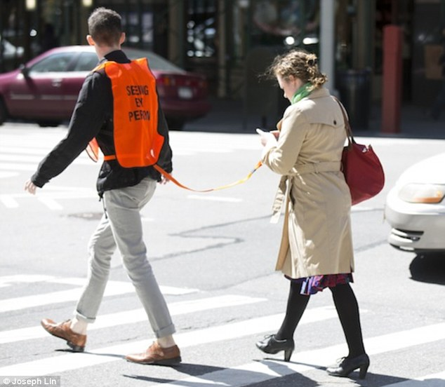 Yes, a seeing eye person is a real thing so you can text without getting hit by a car